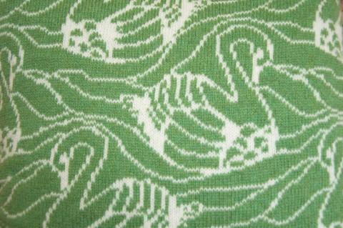 Nervous Stitch, green swan cushion, detail of knitted pattern