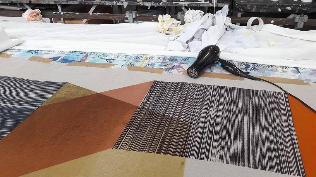 Georgina Hickey, drying fabric.