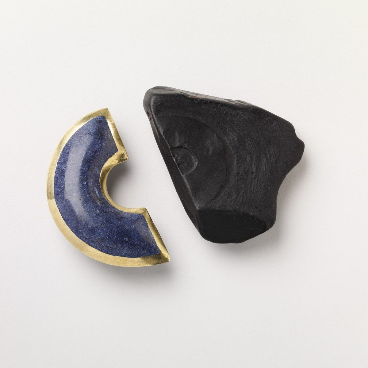 Caitlin Hegney - Azure Brooch and Woad Brooch, brass, jesmonite, oxidised silver, jet.