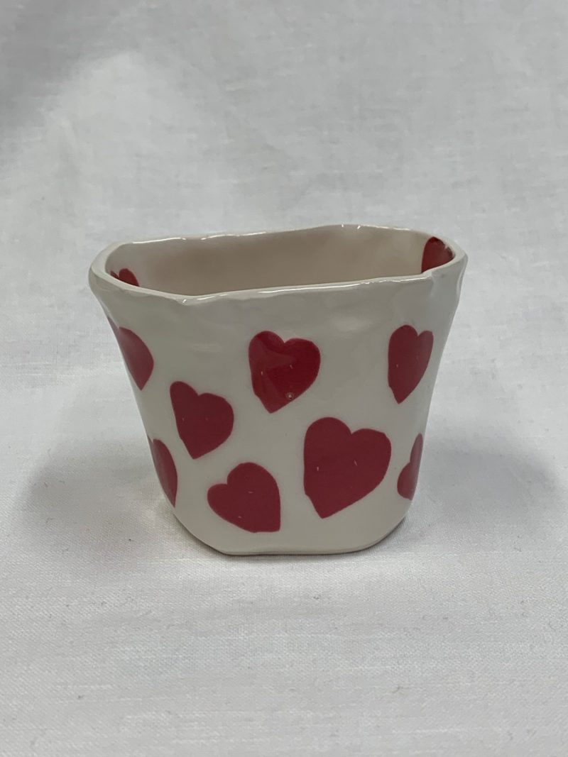 Small tapered ceramic vessel with hearts' design