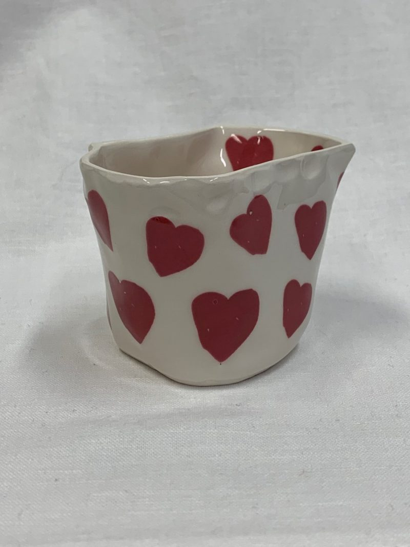Small tapered ceramic vessel with hearts design