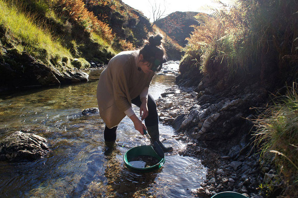 Stefanie Cheong searching for rocks in a Scottish river