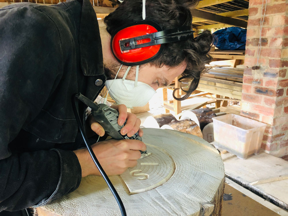 Sebastian Chaloner carving one of The Trail of Thought artworks